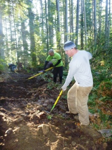 Bill Evans and David Conley digging up lots of Chuckanut sandstone to form a base for a bench.
