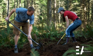 Craig and Oso moving dirt.