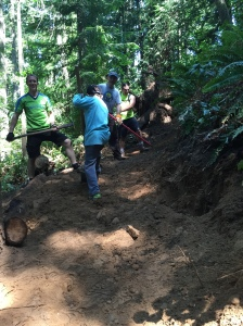 Mark, Rick, Dylan and jesse building a berm after a short, but steep chute.