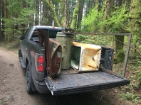 John's truck loaded up with a water heater, screen door, fridge, car door and car trunk.