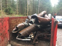 Metal bin is loaded with old culverts, cars and random other metal bits taken off the hill.