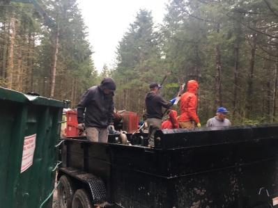 Unloading the dump trailer.