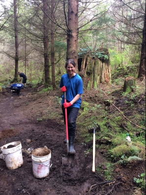 Laura is all smiles while moving dirt on the Lair of the Bear.