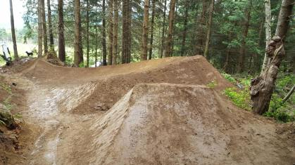 The exit jump's transition got a lot more dirt. The berms before this also got a lot more dirt and allowed more speed.